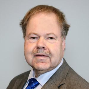 Porträtfoto von Jurymitglied Karl-Peter Naumann