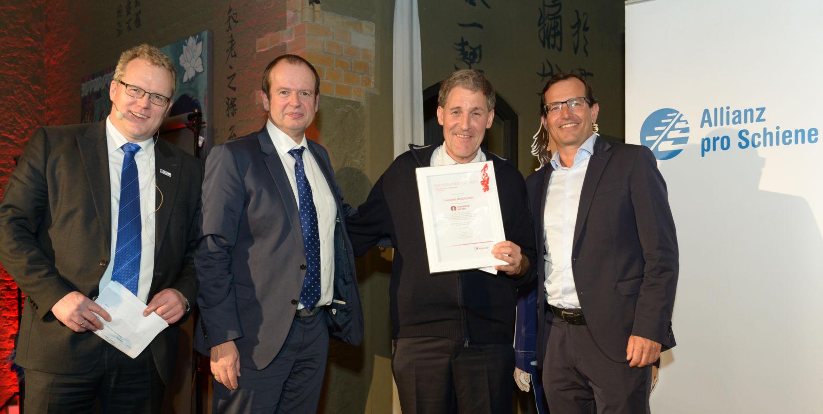 Dirk Flege, Ralf Poppinghuys (Transdev), Preisträger Thomas Hindelang und Christian Schreyer (Transdev)